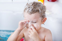 Cute little toddler boy of two years having fun by taking bath i Royalty Free Stock Photo