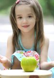 Cute Little Toddler Girl with Apple Stock Photos