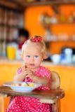 Cute little toddler girl eating breakfast Stock Image