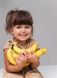 Cute little toddler girl holding a bananas Royalty Free Stock Photography