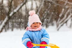 Cute little toddler girl play in winter Stock Images