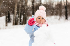 Cute little toddler girl play in winter royalty free stock photography