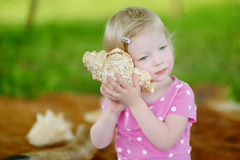 Cute little toddler girl with a shell Royalty Free Stock Photos