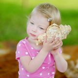 Cute little toddler girl with a shell Royalty Free Stock Images