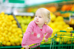 Cute little toddler girl shopping in a food store Stock Photo