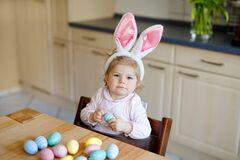 Free Cute Little Toddler Girl Wearing Easter Bunny Ears Playing With Colored Pastel Eggs. Happy Baby Child Unpacking Gifts Royalty Free Stock Images - 210581739