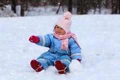 Cute little toddler girl in winter snow Stock Photos