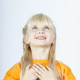 Cute little towhead girl waiting for miracle stock photography