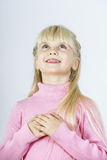 Cute little towhead girl waiting for miracle royalty free stock images