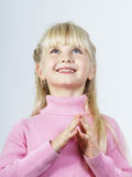 Cute little towhead girl waiting for miracle Stock Photo