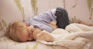 Cute little white boy lying on a sofa Royalty Free Stock Photo