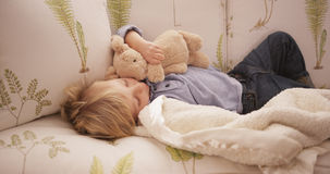 Cute little white boy lying on a sofa Royalty Free Stock Image