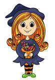 Cute little witch with candies Stock Photo