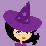 Young Witch Girl Smiling Wearing a Hat Royalty Free Stock Photography
