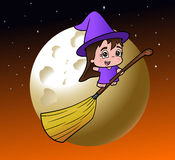 Cute little witch girl on a broom Stock Photos