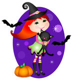 Cute little witch. Cute little girl dressed up as a witch for halloween with her black kitty cat Royalty Free Stock Photos