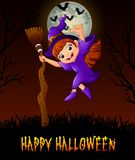 Cute little witch holding a broom while giving thumb up Royalty Free Stock Images