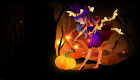 Cute little witch. With pumpkin Stock Images