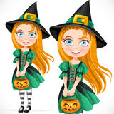Cute little witch with pumpkin for candy Stock Image