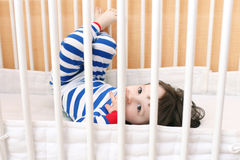 Cute little 2 years child in bed Royalty Free Stock Photos