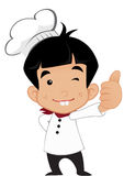 Cute Little Young Boy Chef. In the kitchen Stock Images