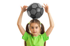 Cute little young girl with soccer ball Stock Photos