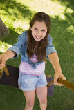 Cute little young girl on swing Stock Image