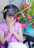 Cute little yuppie girl in prayer royalty free stock photos