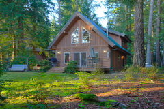 Cute log cabin in the forest. Adorable log cabin in the forest near the lake in Washington State Royalty Free Stock Image