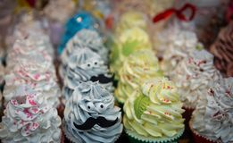 Cute looking cupcakes. Some with faces, decorated beautifully stock photos