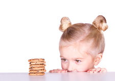A cute looks at a pile of cookies Royalty Free Stock Photo