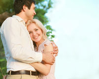 Cute lovely couple enjoying. Outdoors royalty free stock photography