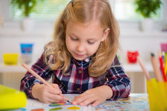 Cute lovely girl drawing at school Stock Photography