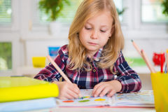 Cute lovely girl drawing at school Stock Photo