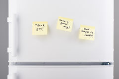 Cute, lovely notes on light yellow sticky paper on refrigerator Stock Photos