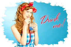 Cute Lovely redhead pin-up girl drinks a drink. From tube royalty free stock photo