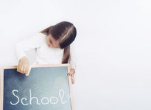 Cute lovely school girl holding chalkboard, education concept Royalty Free Stock Photos