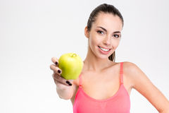 Cute lovely smiling fitness girl holding an apple Royalty Free Stock Images