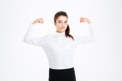 Cute lovely young businesswoman showing biceps. Over white background royalty free stock photos
