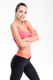Cute lovely young fitness woman posing with folded hands Royalty Free Stock Image
