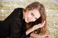 Cute lovely young woman  with sequins on her hair Stock Image