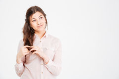Cute lovely young woman thinking and dreaming Royalty Free Stock Image