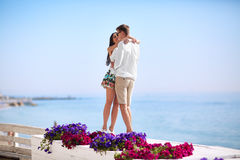Cute lovers on a blue ocean background. Happy relationship. A romantic couple on a honeymoon. Romance and dating. Copy Stock Photography