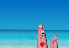 Fingers connected by a heart with their children Stock Images