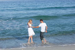 Cute lovers having fun at the seaside Royalty Free Stock Photography
