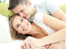 Cute lovers having fun together in the living-room Stock Photography
