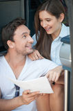 Cute loving couple is planning their journey Stock Photo