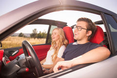 Cute loving couple is traveling by their transport Stock Images