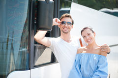 Cute loving couple is using a public transport Royalty Free Stock Images