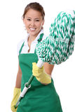 Cute Maid With Mop. A cute young maid with mop getting ready to clean stock photography